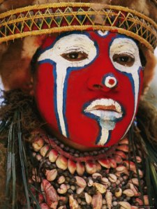 a-tribal-woman-clad-with-shell-necklaces-and-bright-face-paint