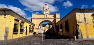 trip-banners_central-america_guatemala_TCGCAJ_CMCG_banner_guatemala_antigua_architecture_arches_city_yellow